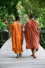 monks walking across a bridge at Beng Milea Temple